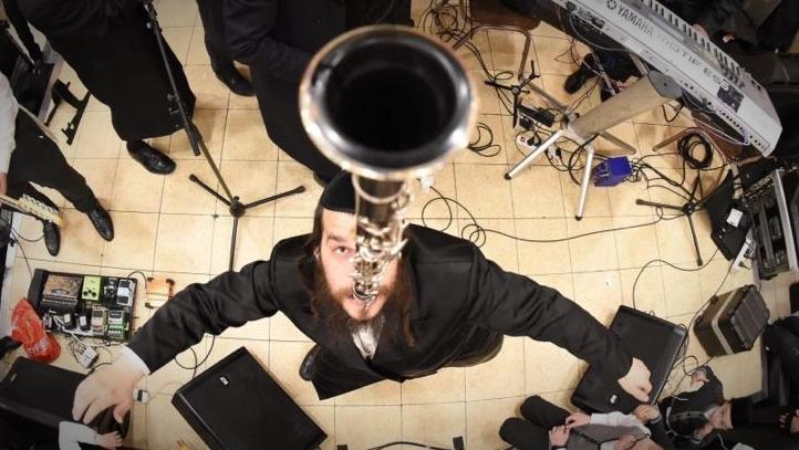 דוד קליגר קלרינט על השיניים צילום אריאל רבינסקי