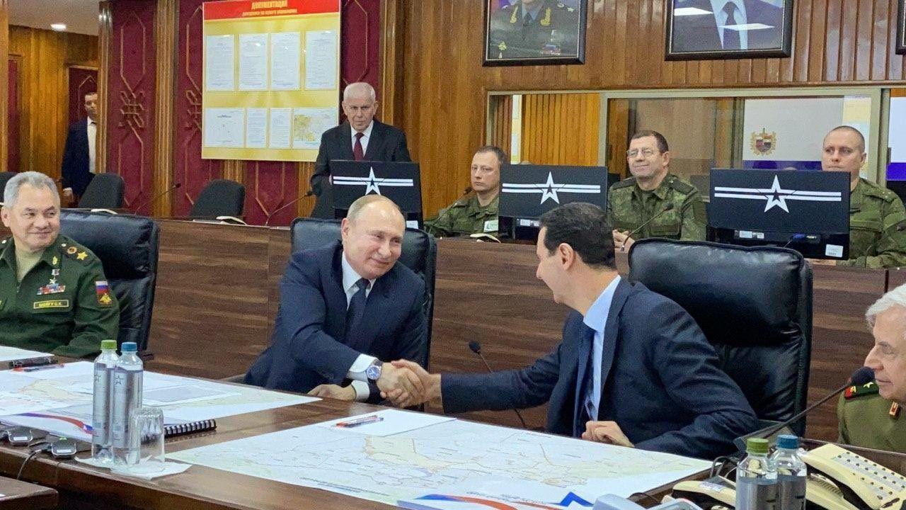 פוטין בפגישתו עם אסאד